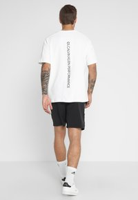Calvin Klein Performance - SHORT - Sports shorts - black - 2