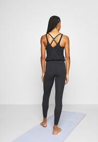 Nike Performance - YOGA JUMPSUIT - Tuta sportiva - black/dark smoke grey - 2
