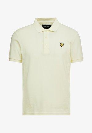 Poloshirt - buttercream