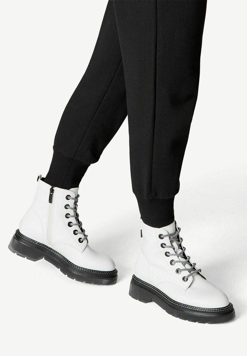 Tamaris - Platform ankle boots - white/black