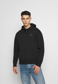 Hollister Co. - GENDERLESS ICON - Hoodie met rits - black - 0