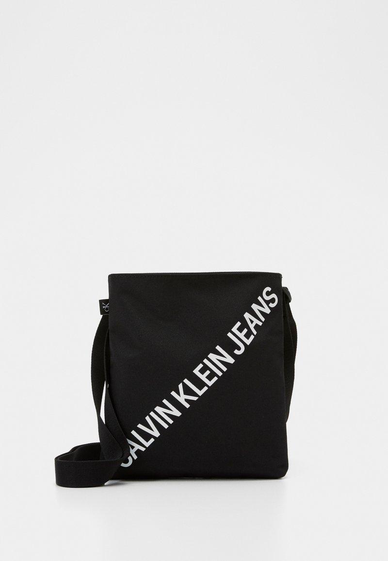 Calvin Klein Jeans - FLATPACK  - Across body bag - black