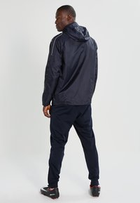 JAKO - TEAM - Waterproof jacket - marine - 3