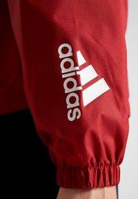 adidas Performance - Sportovní bunda - maroon/legend ink/white - 7