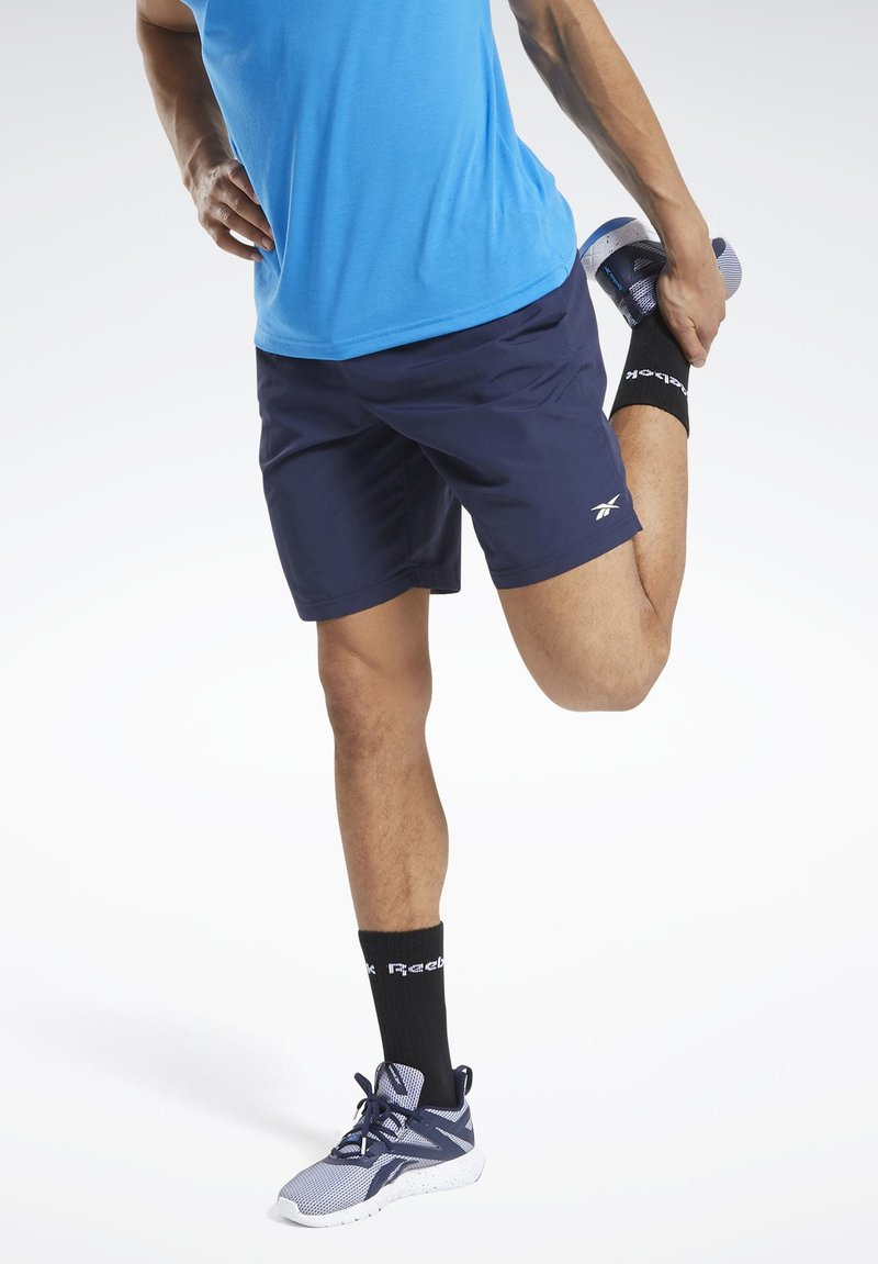 Reebok - UTILITY ESSENTIALS TRAINING 1/2 - Pantaloncini sportivi - blue