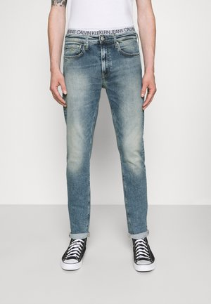 SLIM TAPER - Slim fit jeans - denim light