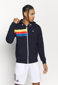 Lacoste Sport - RAINBOW JACKET - Zip-up hoodie - navy blue/wasp/gladiolus/utramarine/white - 0
