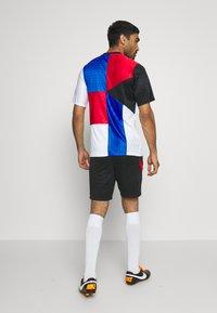 Nike Performance - TÜRKEI DRY SHORT - Sports shorts - black/habanero red/habanero red - 2