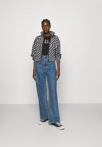 Calvin Klein Jeans - PACKABLE HOOD WINDBREAKER - Summer jacket - black - 1