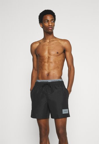 CORE SOLIDS DOUBLE  - Swimming shorts - black