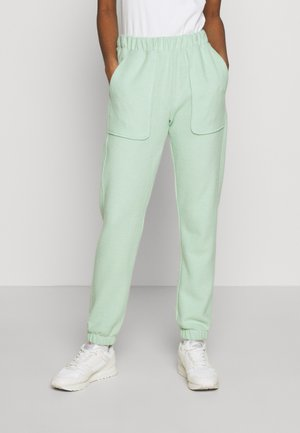 BRUSHED - Tracksuit bottoms - green