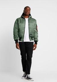 Alpha Industries - HOODED PUFFER - Light jacket - vintage green - 1