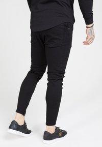 SIKSILK - Spodnie materiałowe - black - 2