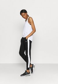 Fila - LAKI PANTS - Spodnie treningowe - black/bright white - 1