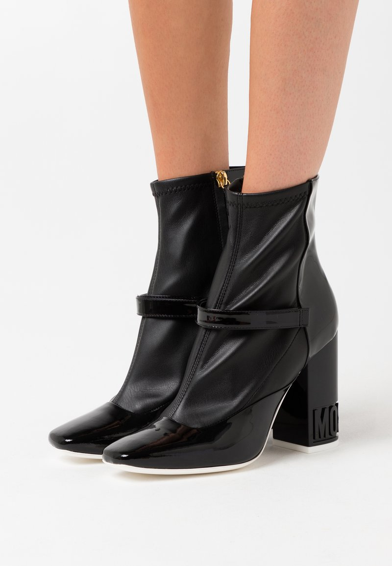 MOSCHINO - High heeled ankle boots - nero