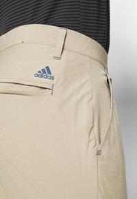 adidas Golf - ULTIMATE PANT - Kalhoty - raw gold - 4
