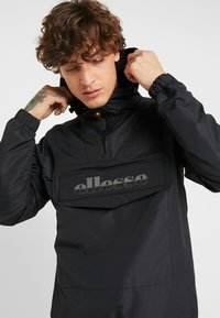 Ellesse - MONT REFLECTIVE - Summer jacket - black - 4