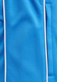 Hummel - TAPERED  - Tracksuit bottoms - blue aster - 4