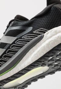 adidas Performance - SOLAR GLIDE BOOST SHOES - Neutral running shoes - core black/silver metallic/signal green - 4
