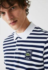 Lacoste - Polo shirt - bleu  blanc - 2