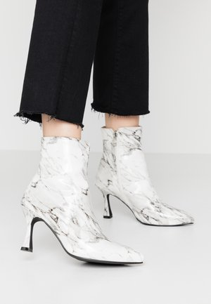 JOLINA - Classic ankle boots - white