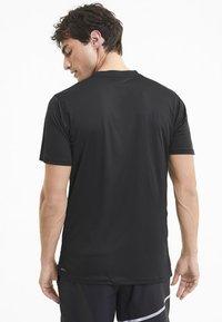 Puma - Print T-shirt -  black-quiet shade - 2