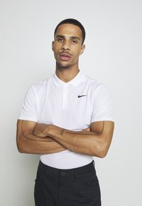 Nike Performance - DRY VICTORY SOLID SLIM - Sports shirt - white/black - 3