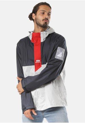 YU RAIN - Waterproof jacket - blue