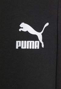 Puma - CLASSICS TECH - Tracksuit bottoms - black - 2