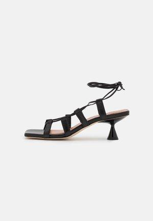 MALIA - Flip Flops - black