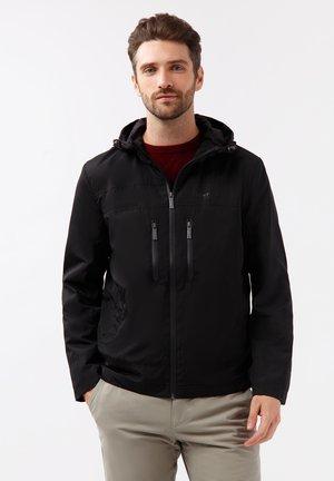 MIT PRAKTISCHEN REISSVERSCHLUSSTASCHEN - Light jacket - black