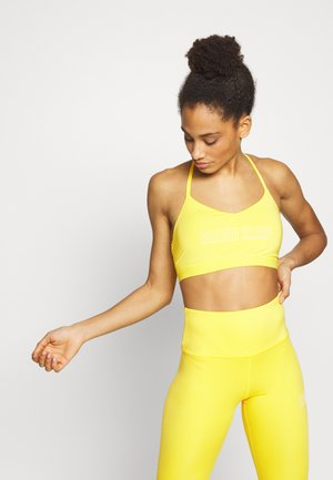 LOW SUPPORT SPORTS BRA - Sports bra - yellow