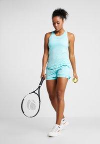 Nike Performance - DRY TANK - Sportshirt - light aqua/white - 1