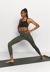 Nike Performance - LUXE BRA - Medium support sports bra - black - 1