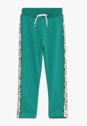 Pantalones deportivos - grün