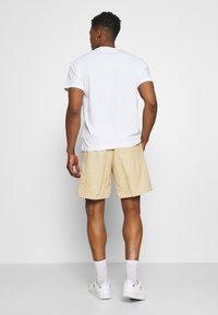 adidas Originals - WOVEN UNISEX - Shorts - hazy beige - 2