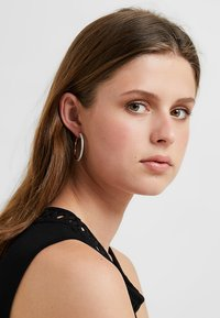 Swarovski - HOOP - Earrings - silver-coloured - 1
