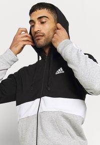 adidas Performance - COLORBLOCK FULL ZIP ESSENTIALS - Zip-up sweatshirt - black/white - 3