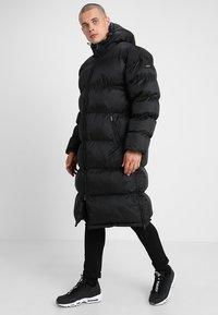 Schott - MAX UNISEX - Płaszcz zimowy - black - 0
