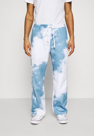 CLOUD - Tracksuit bottoms - blue/white