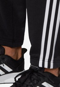 adidas Performance - ESSENTIALS 3STRIPES FRENCH TERRY SPORT PANTS - Träningsbyxor - black