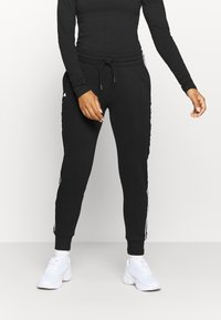 Kappa - HARRIET - Tracksuit bottoms - caviar - 0
