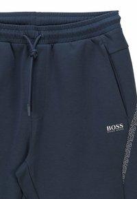 BOSS - HADIKO  - Tracksuit bottoms - dark blue - 5