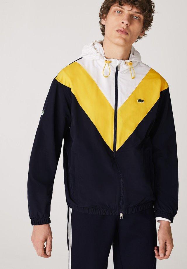 Veste de survêtement - bleu marine / jaune / blanc