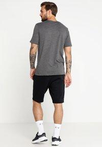 Under Armour - FOUNDATION - Print T-shirt - charcoal medium heather/graphite/black - 2