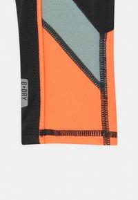 ONLY Play - ONPDANDO GIRLS - Leggings - black/gray mist/sunset orange - 2