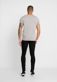 Jack & Jones - JJILIAM JJORIGINAL  - Slim fit jeans - black - 2
