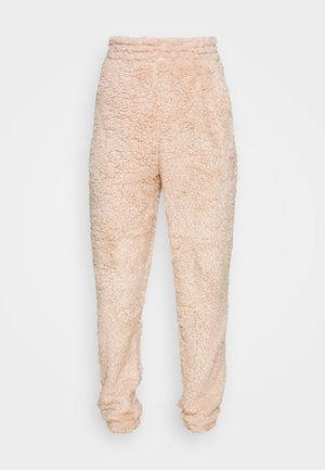 TEDDY JOGGERS - Tracksuit bottoms - camel