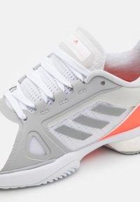 adidas Performance - STELLA COURT - Multicourt tennis shoes - footwear white/silver metallic/solar red - 5
