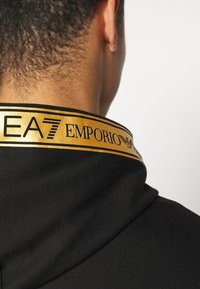 EA7 Emporio Armani - Zip-up hoodie - black/gold - 5
